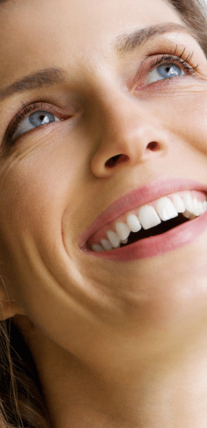 STORY aesthetic results - woman smiling with amazing skin